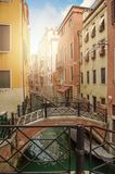 Brige through canal waters of Venice Italy.  stock photos