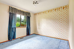 Brigh empty room with blue curtains and carpet floor Royalty Free Stock Photo