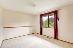 Brigh white empty room with burgundy curtains Stock Photography