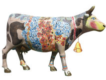 Brighn colored wooden cow mock isolated over white background Royalty Free Stock Photo