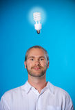 Bright. Man with a beard with a light bulb royalty free stock photo