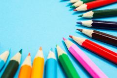 Bright abstract background of multi-colored pencils in the shape of a circle, top view. Space for text stock image