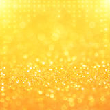Bright and abstract blurred orange and gold bokeh background Stock Photo