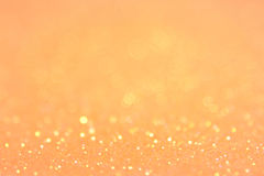 Bright and abstract blurred orange and gold bokeh background Royalty Free Stock Photos