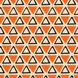 Bright abstract Halloween Seamless orange and black pattern made from hand drawn triangles Stock Image