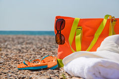 Bright accessories on the beach. Lit by the sun Royalty Free Stock Photos