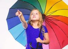 Bright accessory for autumn. Small girl with umbrella rainy day weather. Little girl with umbrella. Autumn fashion. Stay. Positive though autumn rain season stock photo