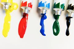 Bright acrylic paints. Brighten your life with bright colors royalty free stock image
