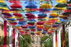 Bright advertising with umbrellas in the street Royalty Free Stock Image