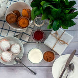 Bright and airy breakfast with muffin, berry jam and milk in glass. Top view, instagram square Royalty Free Stock Photos