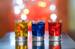 Bright alcohol drinks or berries cocktail in Royalty Free Stock Photo