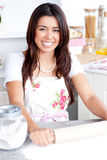 Bright asian woman baking in the kitchen Stock Photo
