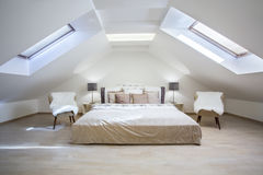 Bright attic bedroom in the  apartment Royalty Free Stock Images