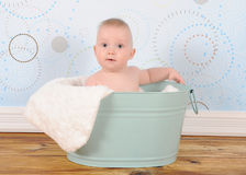 Bright baby boy sitting in wastub Royalty Free Stock Photo