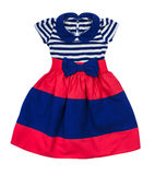 Bright baby dress in blue and red stripes Stock Photography