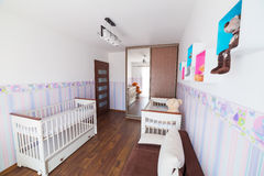 Bright baby room with white cradles. Bright baby room with pastel wallpapers and white cradles Stock Photos