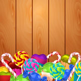 Bright background with candies on wood Stock Image