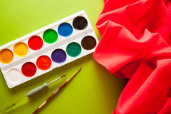 Bright background for craftsmanship. Bright colorful background with red silky drapery Royalty Free Stock Images