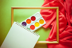 Bright background for craftsmanship. Bright colorful background with red silky drapery Stock Images