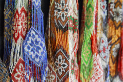 Bright background of handmade strands of colorful beads Royalty Free Stock Photography
