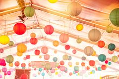 Bright background with many colorful chinese round lantern decorating the ceiling of hall at celebrating event, festival, party. P. Arty decoration concept. Soft royalty free stock image