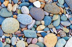 Free Bright Background Of Multi-colored Round Stones, Sea Pebbles, Close Up. Stock Photo - 122709100