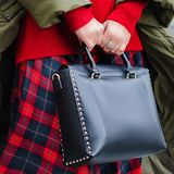 A bright bag in women`s hands. Leather bag. Royalty Free Stock Photography