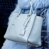 A bright bag in women`s hands. Leather bag. Royalty Free Stock Images
