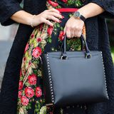 A bright bag in women`s hands. Leather bag. Royalty Free Stock Photo