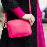 A bright bag in women`s hands. Leather bag. Stock Image