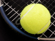 Bright Ball. Close of tennis ball on racquet Stock Photography