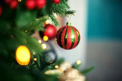 Bright ball on the Christmas tree. The concept of Christmas and Stock Photos