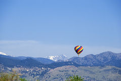 Bright Balloon Over Blue Mountains Royalty Free Stock Images