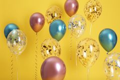 Bright balloons with ribbons. On color background stock photo