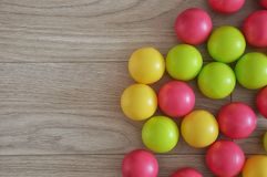 Bright balls on a wooden background royalty free stock photo