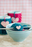 Bright balls of yarn in blue plates and handmade from heart Royalty Free Stock Images