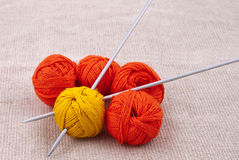 Bright balls of yarn with knitting needles Stock Photography