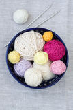 Bright balls of yarn and knitting needles Stock Image