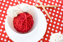 Bright balls of yarn and knitting needles on a polka dot background Royalty Free Stock Images