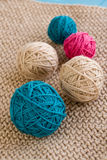 Bright balls of yarn lying on knitted plaid Stock Photography