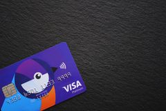 Bright banking card on black stock photo