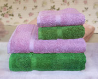 Bright  bath towels. Bright pink and green terry bath towels in a shop window Stock Image