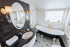 Bright bathroom in baroque style Royalty Free Stock Photo