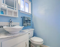 Bright bathroom with blue walls. Royalty Free Stock Photography