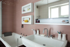 Bright bathroom with chrome tap Stock Photography