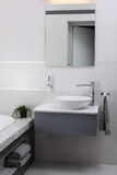 Bright bathroom with chrome tap Royalty Free Stock Photos