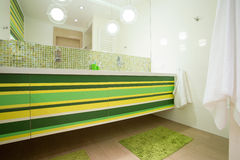 Bright bathroom with green elements Stock Photos