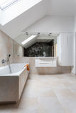 Bright bathroom with huge bath. And mirror stock photos