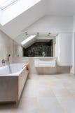 Bright bathroom with huge bath Stock Photos