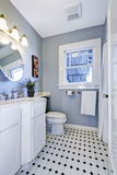Bright bathroom interior in light blue color Stock Image